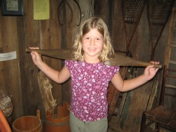 Ella with a yoke like Almanzo might have used to carry water